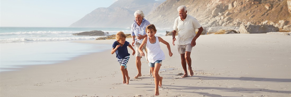 grandparents playing with their grandchildren in retirement - superannuation savings